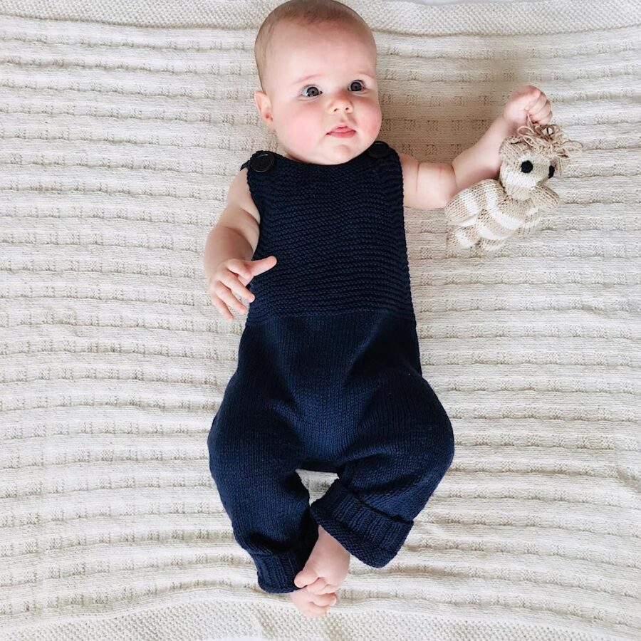 Knit for Life Long- legged singlet style jumpsuit, romper, onesie. Hand knitted in Zimbabwe. Charity ethical fashion for babies. Natural baby brand. Knit for Life