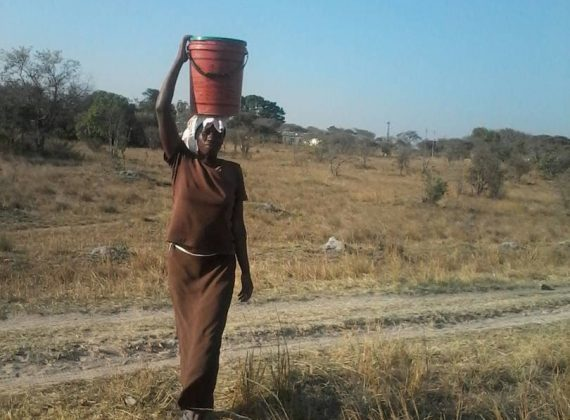Maria collects water for her family