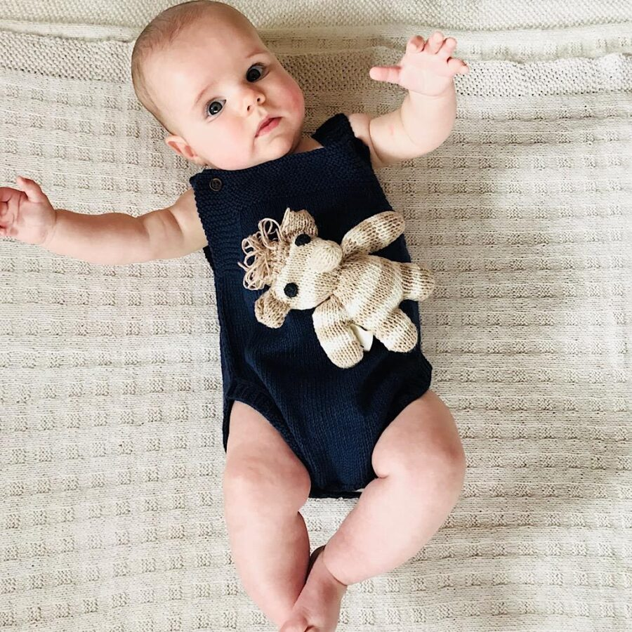 Navy baby romper onesie. Handmade in Zimbabwe by a community of women knitters. Knit for Life is a registered charity. Our natural cotton baby and kids clothes empower a community.