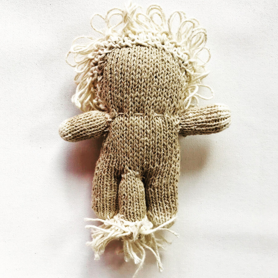 Small soft baby toy lion. Handmade from naturally grown cotton in rural Zimbabwe. Knit for Life is a registered charity.